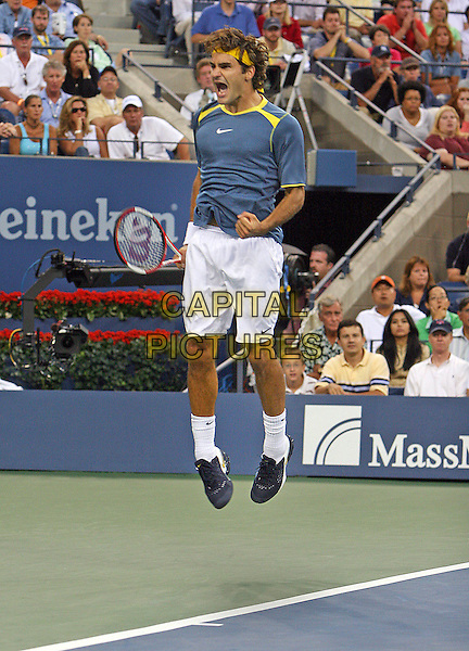 ROGER FEDERER.Atmosphere before 2005 US Open Tennis Men's Championship starts, Flushing, NY. .September 11th, 2005.Photo Credit Jackson Lee/Admedia.full length jumping blue shirt white shorts yellow headband.www.capitalpictures.com.sales@capitalpictures.com.© Capital Pictures.