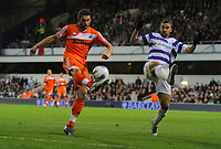 FAO SPORTS PICTURE DESK<br /> Pictured L-R: Angel Rangel of Swansea crosses the ball while being marked by Adel Taarabt of QPR. Wednesday, 11 April 2012<br /> Re: Premier League football, Queens Park Rangers v Swansea City FC Loftus Road Stadium, London.