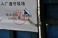 A notice posts on the closed factory gates belonging to Smart Union saying that the company cannot pay the salaries to the workers. The Zhang Mutou Town Government is going to pay the salaries for the Smart Union as a loan to the company. Smart Union is one of several factories in South China that went bankrupt in the current credit crisis. Smart Union, that produced toys for Mattel amongst others, left 6,000 workers jobless and penniless. Hundreds of factories in South China are closing due to increased labor and material costs and the current credit crissis is exasperating. The problem leaving ghost towns behind. .24 Oct 2008