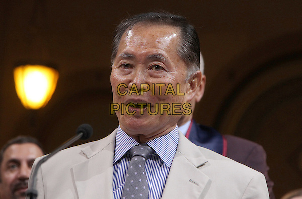 George Takei.The 2nd Annual LGBT Heritage Month in the City of Los Angeles Held at Los Angeles City Hall, Los Angeles, California, USA..June 1st, 2012.headshot portrait purple shirt beige suit mouth open jacket .CAP/ADM/FS.©Faye Sadou/AdMedia/Capital Pictures.