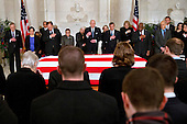 United States Supreme Court Justices make the sign of the cross during prayers at a private ceremony in the Great Hall of the US Supreme Court where late Supreme Court Justice Antonin Scalia lies in repose in Washington, DC on Friday, February 19, 2016. From back left are Counselor to the Chief Justice Jeffrey Minear, and Supreme Court Justices Elena Kagan, Samuel Anthony Alito, Jr., Ruth Bader Ginsburg, Anthony M. Kennedy, Chief Justice John G. Roberts, Jr., Clarence Thomas, Stephen G. Breyer, and Sonia Sotomayor. <br /> Credit: Jacquelyn Martin / Pool via CNP