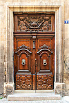 Carved wooden door, probably dating from the 18th century, in Aix-en-Provence