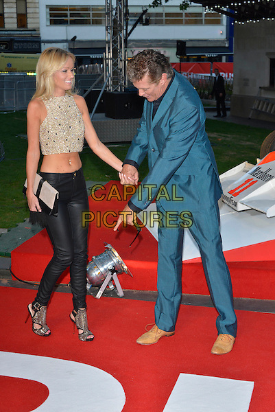 Hayley Roberts and David Hasselhoff<br /> 'Rush' world film premiere at the Odeon Leicester Square cinema, London, England.<br /> 2nd September 2013<br /> full length gold embellished jewel encrusted cropped top belly stomach midriff black leather trousers blue suit couple clutch bag holding hands profile hand arm finger pointing at shoes<br /> CAP/PL<br /> &not;&copy;Phil Loftus/Capital Pictures