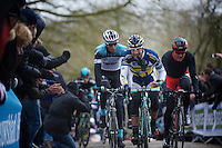 Gent-Wevelgem 2013.Juan Antonio Flecha (ESP) getting rid of the gloves.