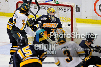 16 November 2008: Merrimack College Warriors' goaltender Andrew Braithwaite, a Junior from Kingston, Ontario, keeps his eye on the drifting puck during third period play against the University of Vermont Catamounts at Gutterson Fieldhouse, in Burlington, Vermont. The Catamounts defeated the Warriors 2-1 in front of a near-capacity crowd of 3,813...Mandatory Photo Credit: Ed Wolfstein Photo