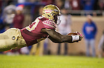 Florida State fullback Freedie Stevenson dives into the endzone after a 27 yard touchdown run in the second half of an NCAA college football game against Florida in Tallahassee, Fla., Saturday, Nov. 26, 2016.  Florida State defeated Florida 31-13.  (AP Photo/Mark Wallheiser)