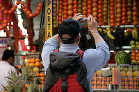 Tourist taking a photo of fruit, Istanbul, Turkey