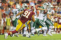 Landover, MD - August 16, 2018: Washington Redskins linebacker Ryan Kerrigan (91) chases New York Jets quarterback Sam Darnold (14) during the preseason game between New York Jets and Washington Redskins at FedEx Field in Landover, MD.   (Photo by Elliott Brown/Media Images International)