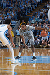 Brandon Childress (0) of the Wake Forest Demon Deacons is guarded by Joel Berry II (2) of the North Carolina Tar Heels at the Dean Smith Center on December 30, 2017 in Chapel Hill, North Carolina.  The Tar Heels defeated the Demon Deacons 73-69.  (Brian Westerholt/Sports On Film)