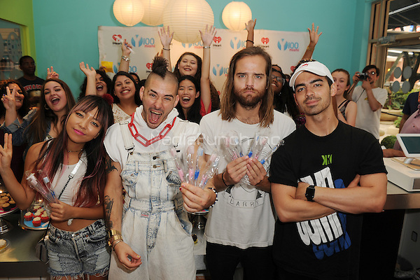 MIAMI, FL - JUNE 11: JinJoo Lee, Cole Whittle, Jack Lawless and Joe Jonas of DNCE attend Radio Station Y-100's cup cake and toothbrush party at LA Sweets on June 11, 2016 in Miami, Florida. Credit: mpi04/MediaPunch