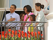 United States President Barack Obama, Michelle's mother Marian Robinson, First Lady Michelle Obama and their daughters Sasha and Malia (L to R) listen to the National Anthem during the White House Easter Egg Roll in Washington on Monday, April 5, 2010. .Credit: Roger L. Wollenberg / Pool via CNP
