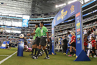 Referees enter the field prior to the start of the match between USMNT and Honduras on July 24, 2013 at Dallas Cowboys Stadium in Arlington, TX.