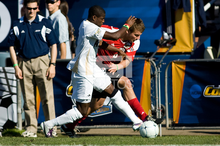 Akron's Kofi Sarkodie (8) battles Louisville's Nick Corliss (6). 2010 NCAA D1 College Cup Championship Final Akron defeated Louisville 1-0 at Harder Stadium on the campus of UCSB in Santa Barbara, California on Sunday December 12, 2010.