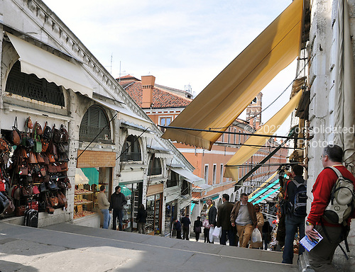 Venice, Italy - March 17, 2009 -- Retail shops line both sides of the steps as tourists shop on the Rialto Bridge over the Grand Canal in Venice, Italy on Tuesday, March 17, 2009.  This view is looking down the steps from the middle of the bridge..Credit: Ron Sachs / CNP