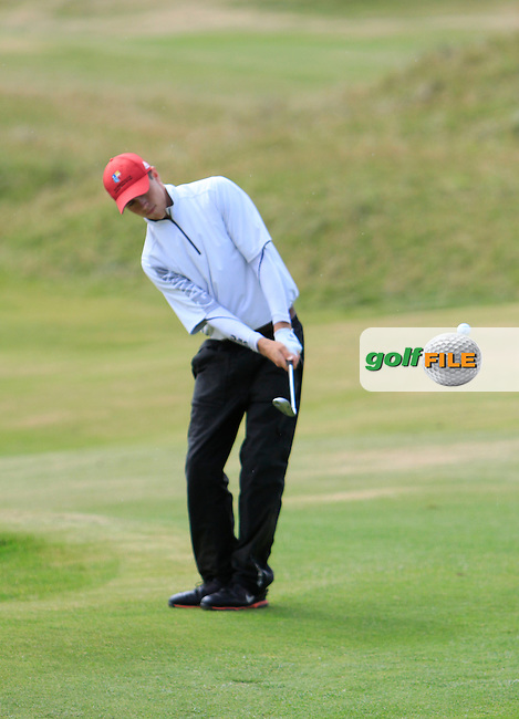 Shaun Carter (Stackstown/NUIM) chipping onto the 15th green during the South of Ireland Amateur Open Championship Third Round at Lahinch Golf Club  29th July 2013 <br /> Picture:  Thos Caffrey / www.golffile.ie