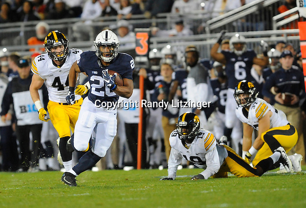 STATE COLLEGE, PA - NOVEMBER 05:  Penn State RB Saquon Barkley (26) eludes several Iowa defenders during a long touchdown run. The Penn State Nittany Lions defeated the Iowa Hawkeyes 41-14 on November 5, 2016 at Beaver Stadium in State College, PA. (Photo by Randy Litzinger/Icon Sportswire)