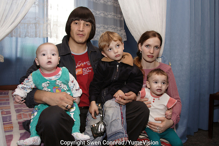 A Chechen man with his wife, two sons and  daughter at the URiC Wola Center in Warsaw..He and his family survived while the first and second war and spent last 4 years in shelter-tent refugee camp in Ingushetia until Russian authority close them. There is not any other choice for them than to die in Chechnya or continue to survive asking for the asylum in Poland..-For security reason, the names of the adult asylum seeker have been change. .-Article 9 of the Act of 13 June 2003 on grating protection on the Polish territory (Journal of Laws, No 128, it. 1176) personal data of refugees are an object of particular protection..-Cases where publication of a picture or name of asylum seeker had dramatic consequences for this persons and is family back in Chechnya. .Please have safety of those people in mind. Thank you.