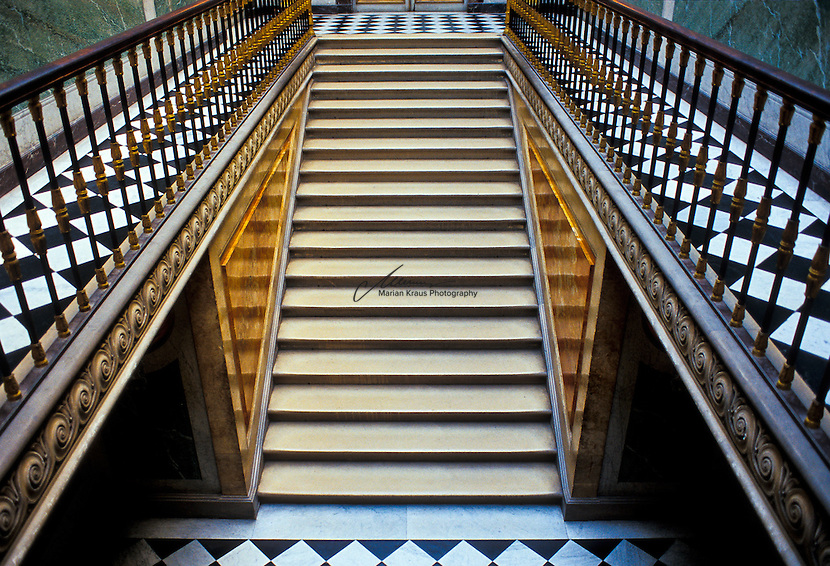 Wonderfully crafted staircase at the Palais du Versailles. When the château was built, Versailles was a country village; today, however, it is a suburb of Paris, some 20 kilometres southwest of the French capital. The court of Versailles was the centre of political power in France from 1682, when Louis XIV moved from Paris, until the royal family was forced to return to the capital in October 1789 after the beginning of the French Revolution. Versailles is therefore famous not only as a building, but as a symbol of the system of absolute monarchy of the Ancien Régime.