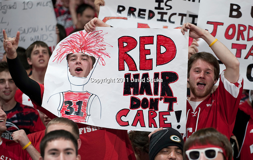 Wisconsin Badgers fans display homemade signs during a Big Ten Conference NCAA men's college basketball game against the Purdue Boilermakers on February 1, 2011 at the Kohl Center in Madison, Wisconsin. Wisconsin won 66-59. (Photo by David Stluka)