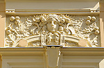 A detail of a woman's face and flowers on a building in Prague, Czech Republic.