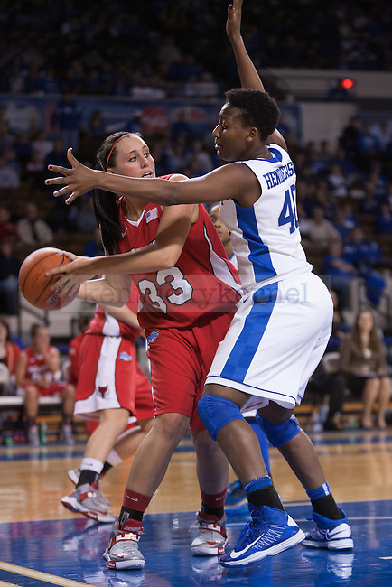 Marist senior guard Kristina Danella (left) being guarded by UK senior forward Brittany Henderson (right)  during the first half of the UK vs. Marist basketball game at Memorial Coliseum on Sunday, Dec. 30, 2012. Photo by Adam Chaffins | Staff