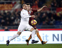Calcio, Serie A: Roma vs Milan. Roma, stadio Olimpico, 12 dicembre 2016.<br /> Milan's Gabriel Paletta, left, and Roma&rsquo;s Stephan El Shaarawy fight for the ball during the Italian Serie A football match between Roma and AC Milan at Rome's Olympic stadium, 12 December 2016.<br /> UPDATE IMAGES PRESS/Isabella Bonotto