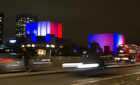 15 July 2016 - London, England - A view from Waterloo Bridge of The National Theatre in London which is illuminated in the colours of the French flag to show solidarity with victims of the Bastille Day massacre. Photo Credit: ALPR/AdMedia