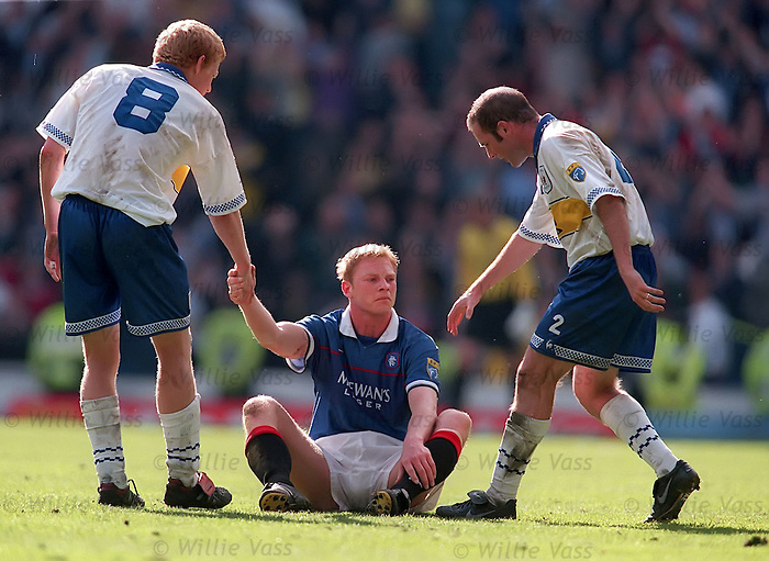 Jorg Albertz slumps to the turf in tears after defeat to Kilmarnock at Ibrox in Walter's last home game as manager
