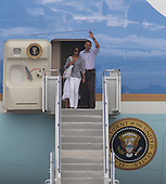 Cape Cod, MA - August 23, 2009 -- United States President Barack Obama, accompanied by his oldest daughter Malia, 11, disembarks Air Force One after the First Family landed at Cape Cod Coast Guard Air Station on Cape Cod, Massachusetts Sunday, August 23, 2009. The First Family then boarded a US Marine helicopeter for their week-long vacation on Martha's Vineyard, Massachusetts. .Credit: Vincent DeWitt - Pool via CNP
