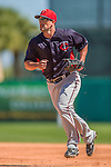 4 March 2013: Minnesota Twins first baseman Brian Dinkelman warms up prior to a Spring Training game against the St. Louis Cardinals at Roger Dean Stadium in Jupiter, Florida. The Twins shut out the Cardinals 7-0 in Grapefruit League play. Mandatory Credit: Ed Wolfstein Photo *** RAW (NEF) Image File Available ***