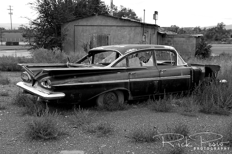 A 1959 Chevy Impala sits abandoned behind along Route 66 in Arizona