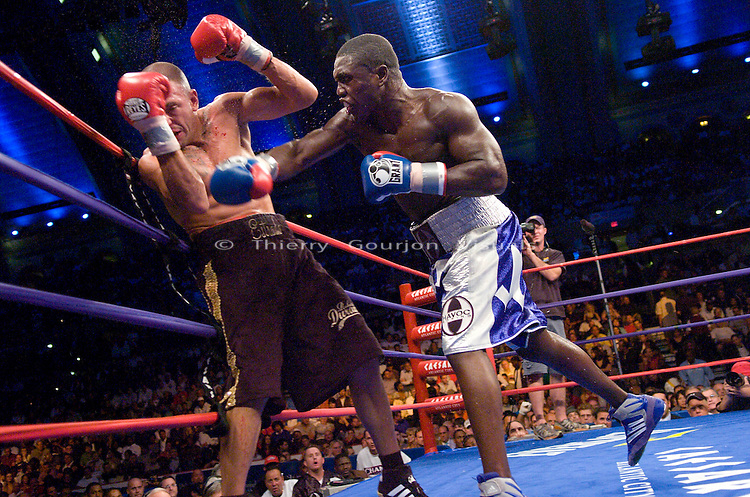 Atlantic City, NJ. 09.29.2007: Andre Berto (white/blue trunk)  and David Estrada(brown) in the ring during their  NABF Welterweight Championship / WBC & IBF eliminator fight at the Boardwalk Hall. Berto won the belt with an eleventh round TKO. Photo by Thierry Gourjon.