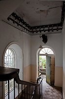 The walls around a staircase in the servants' quarters are lined with bells, each connected to a room upstairs by an ingenious system of pulleys and wires