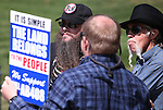 Supporters of AB408 talk outside the Legislative Building in Carson City, Nev., on Tuesday, March 31, 2015. <br /> Photo by Cathleen Allison