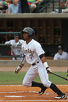 Charleston Riverdogs infielder Angelo Gumps #21 at bat during a game against the Delmarva Shorebirds at Joseph P. Riley Jr. Park on May 6, 2012 in Charleston, South Carolina. Charleston defeated Delmarva by the score of 8-2. (Robert Gurganus/Four Seam Images)