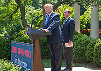 United States President Donald J. Trump announces a &quot;new blueprint&quot; for lowering prescription drug prices in the Rose Garden of the White House in Washington, DC on Friday, May 11, 2018.  US Secretary of Health and Human Services Alex Azar looks on from right.CAP/MPI/RS<br /> &copy;RS/MPI/Capital Pictures