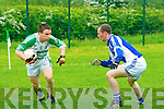 David O'Connon, Ballydonoghue trying to pass Joe Sheahan, Templenoe in the quarter final of the Novice championship clash aat Coolerd on Saturday evening.