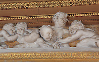 Putti playing in carved stucco from the frame of the fresco the Education of Achilles by Rosso Fiorentino, 1535-37, in the Galerie Francois I, begun 1528, the first great gallery in France and the origination of the Renaissance style in France, Chateau de Fontainebleau, France. The Palace of Fontainebleau is one of the largest French royal palaces and was begun in the early 16th century for Francois I. It was listed as a UNESCO World Heritage Site in 1981. Picture by Manuel Cohen