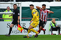Lincoln City's Matt Green vies for possession with Morecambe's Michael Rose<br /> <br /> Photographer Andrew Vaughan/CameraSport<br /> <br /> The EFL Sky Bet League Two - Lincoln City v Morecambe - Saturday August 12th 2017 - Sincil Bank - Lincoln<br /> <br /> World Copyright &copy; 2017 CameraSport. All rights reserved. 43 Linden Ave. Countesthorpe. Leicester. England. LE8 5PG - Tel: +44 (0) 116 277 4147 - admin@camerasport.com - www.camerasport.com