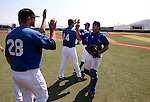 Teammates welcome catcher Taylor Mieras back to the dugout during the alumni game at Western Nevada College in Carson City, Nev., on Saturday, Sept. 7, 2013.  <br /> Photo by Cathleen Allison