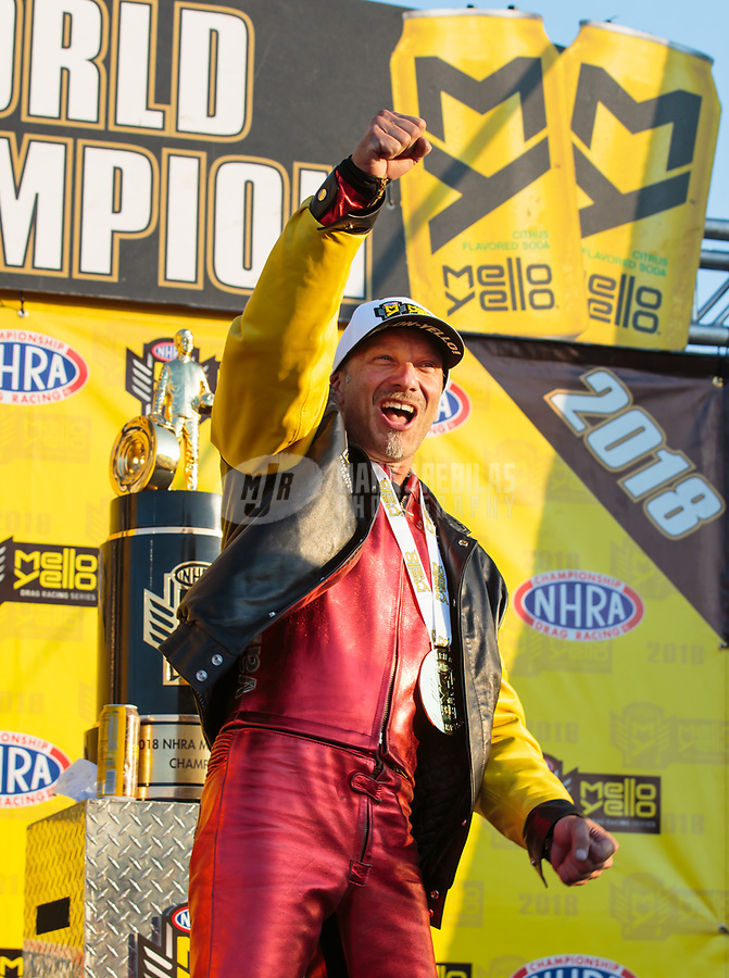 Nov 11, 2018; Pomona, CA, USA; NHRA pro stock motorcycle rider Matt Smith celebrates after clinching the 2018 world championship during the Auto Club Finals at Auto Club Raceway. Mandatory Credit: Mark J. Rebilas-USA TODAY Sports