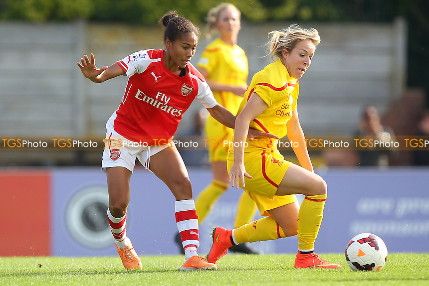 Gemma Davison of Liverpool Ladies battles with Rachel Yankey of Arsenal Ladies - Arsenal Ladies vs Liverpool Ladies - FA Womens Super League Football at Meadow Park, Boreham Wood FC  - 05/10/14 - MANDATORY CREDIT: Gavin Ellis/TGSPHOTO - Self billing applies where appropriate - contact@tgsphoto.co.uk - NO UNPAID USE