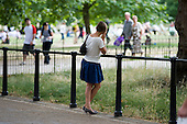 Woman using a mobile phone, Green Park, London.
