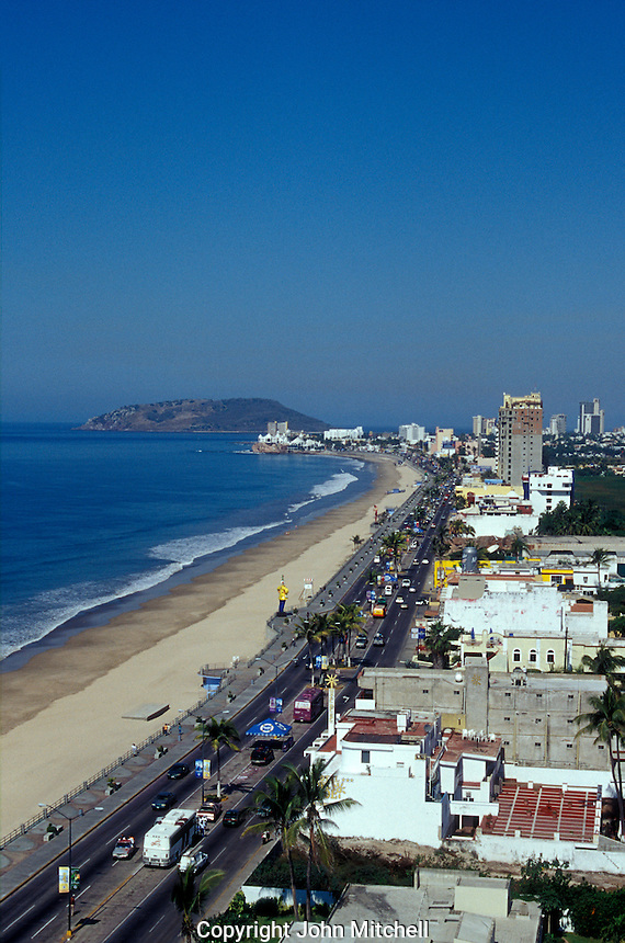 View north along Avenida del Mar showing the Malecon and Playa Norte in Mazatlan, Sinaloa, Mexico. The Zona Dorada or Golden Zone is visible in the distance.