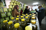 Palestinian Prime Minister Salam Fayyad attends the second annual Olive Festival at Al-Quds Open University in the West Bank city of Hebron on 07 November 2012. Olive oil is the backbone of the Palestinian agricultural economy. Around 80% of cultivated land in Palestine is planted with olive trees. Photo by Mamoun Wazwazi