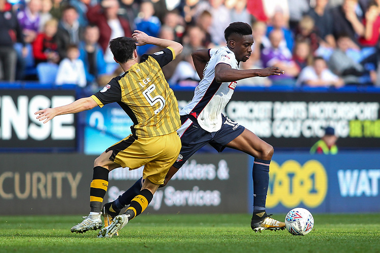 Bolton Wanderers'  Sammy Ameobi competing with Sheffield Wednesday's Kieran Lee<br /> <br /> Photographer Andrew Kearns/CameraSport<br /> <br /> The EFL Sky Bet Championship - Bolton Wanderers v Sheffield Wednesday - Saturday 14th October 2017 - Macron Stadium - Bolton<br /> <br /> World Copyright &copy; 2017 CameraSport. All rights reserved. 43 Linden Ave. Countesthorpe. Leicester. England. LE8 5PG - Tel: +44 (0) 116 277 4147 - admin@camerasport.com - www.camerasport.com