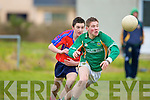 Padraig Nagle St Brendan's College lays the ball off despite ISK's Danny O'Sulllivan in their quarter final clash in Listry on Wednesday