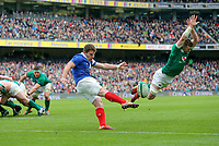 Sunday10th March 2019 | Ireland vs France<br /> <br /> Peter O&rsquo;Mahony attempts to charge down Antoine Dupont's kick during the Guinness 6 Nations clash between Ireland and France at the Aviva Stadium, Lansdowne Road, Dublin, Ireland. Photo by John Dickson / DICKSONDIGITAL