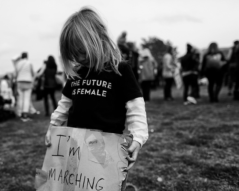 Gwenyth Tackett, 4, of Marina holds a sign during a women's march at California State University Monterey Bay on Jan. 20, 2017.