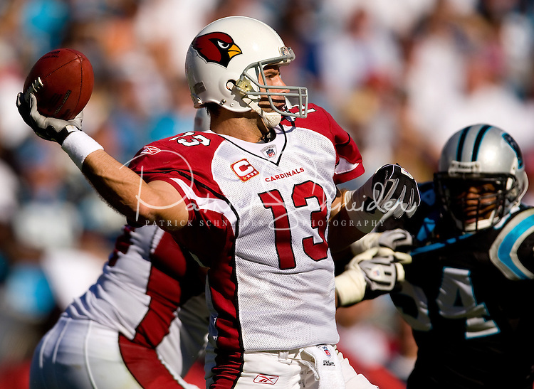 Arizona Cardinals quarterback Kurt Warner (13) works to throw a pass against the Carolina Panthers during an NFL football game at Bank of America Stadium in Charlotte, NC.